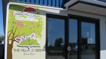 Under His Grace Christian Gift Store logo