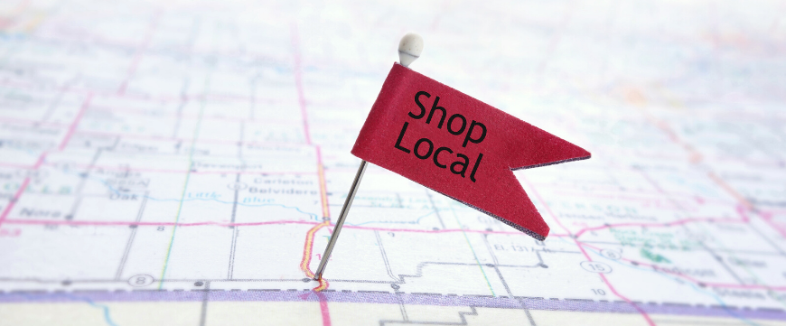 "Map with a pin and flag that reads ""Shop Local"""
